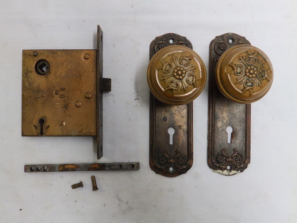 antique door knobs and plates photo - 2
