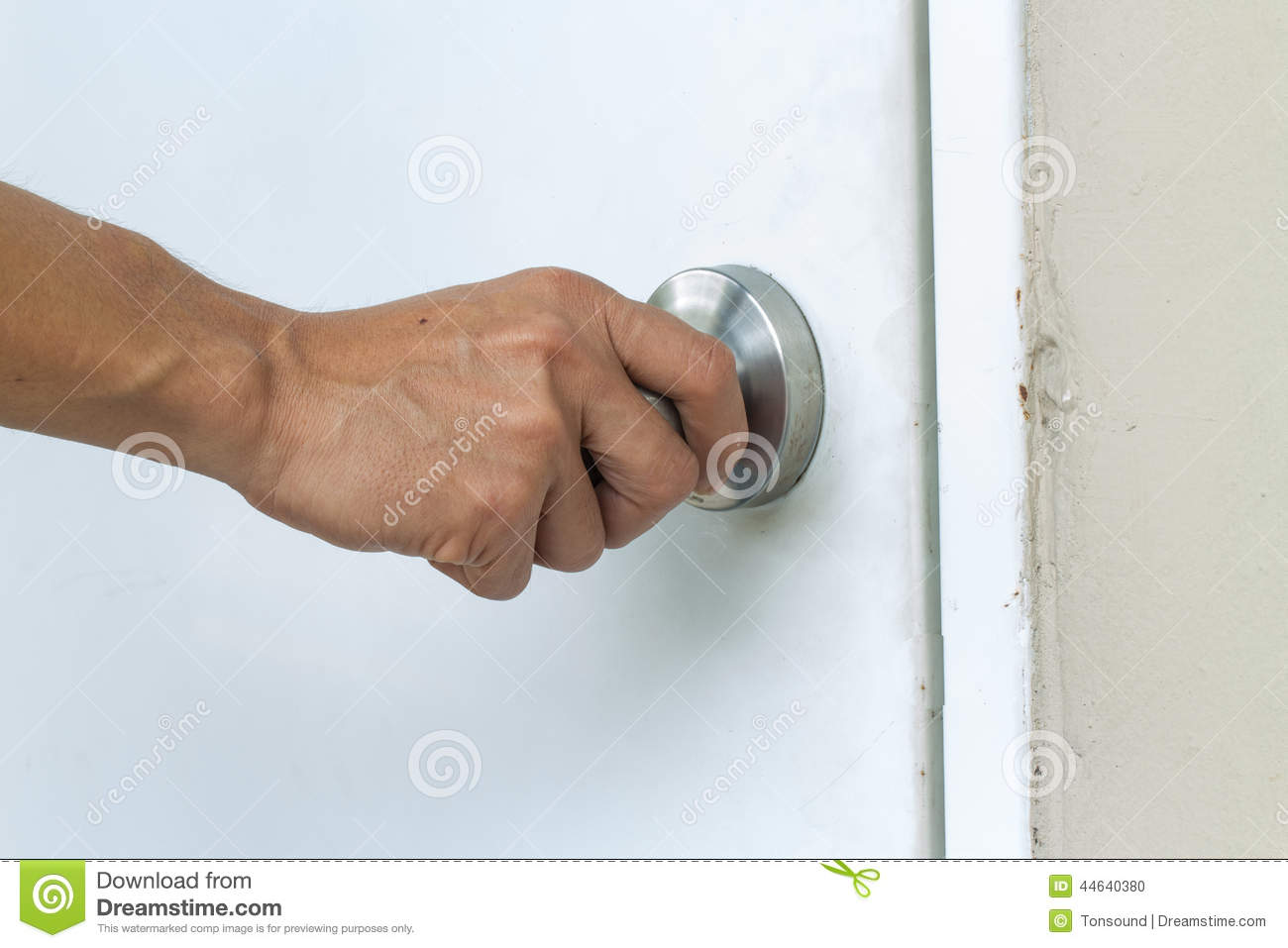hand on door knob photo - 10