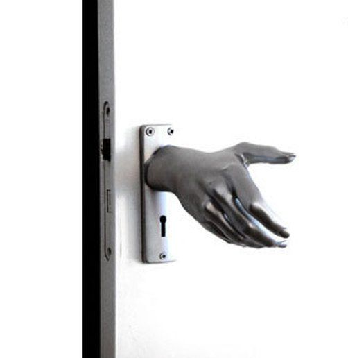 hand on door knob photo - 18