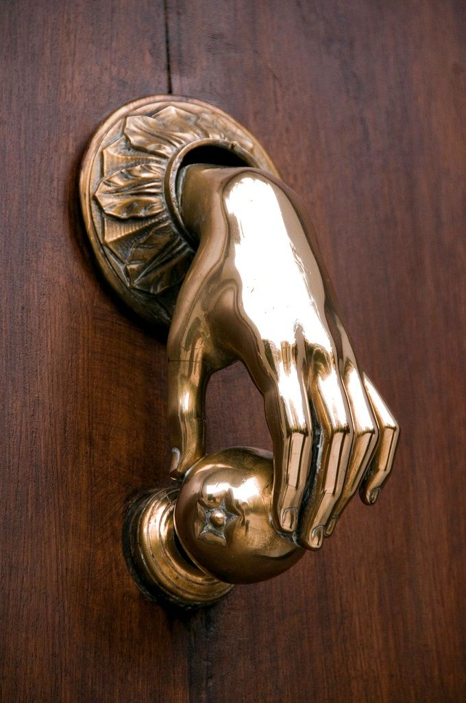 hand on door knob photo - 5