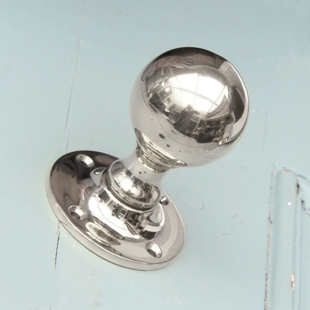 polished nickel door knob photo - 1