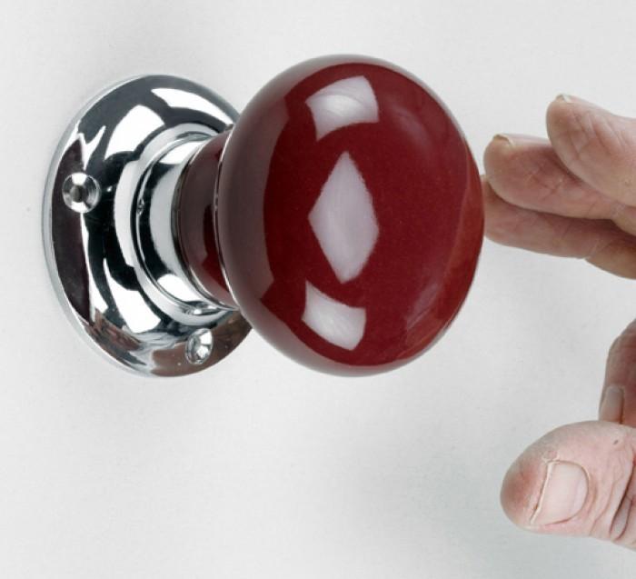 red door knob photo - 2
