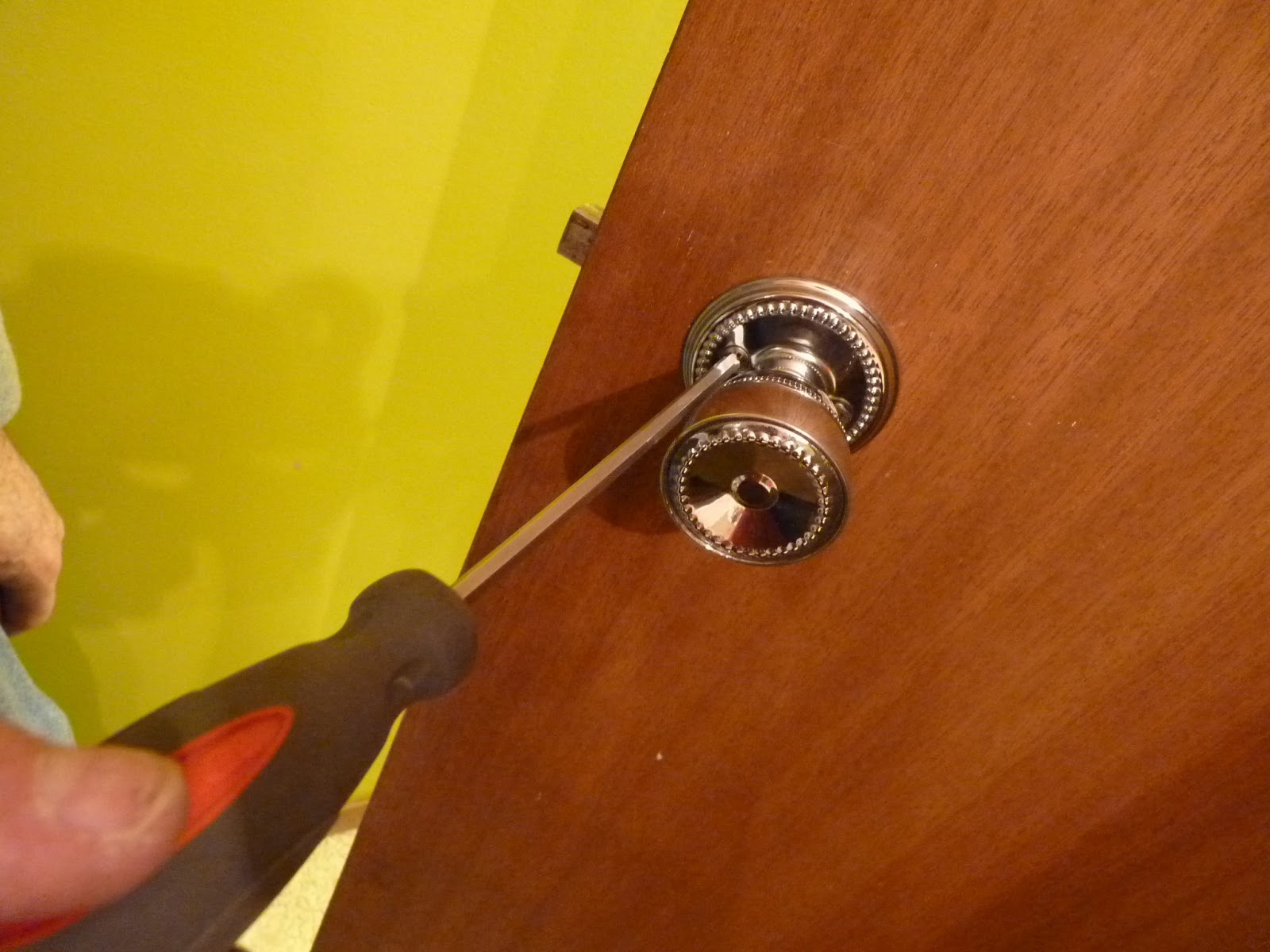 removing old door knobs photo - 12