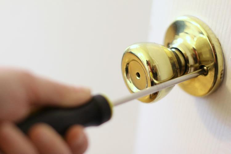 taking off a door knob photo - 2