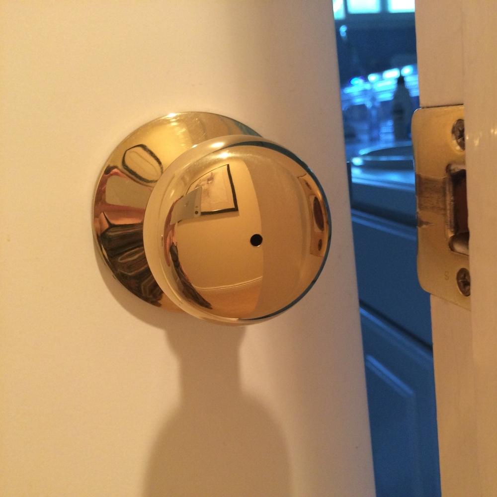 unlocking door knob with hole photo - 1