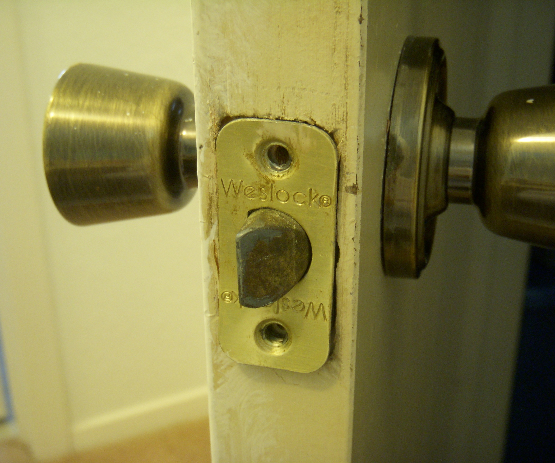 weslock door knob removal photo - 4