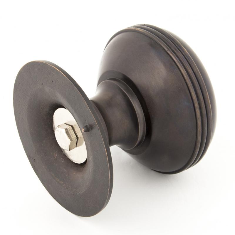 aged bronze door knobs photo - 1