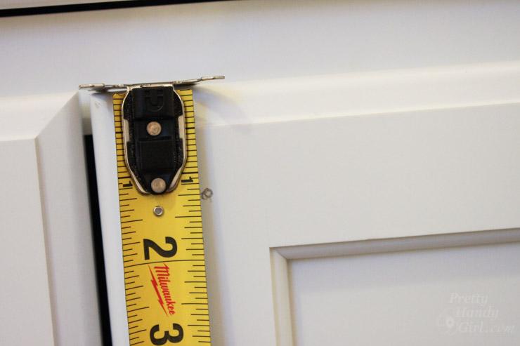 cabinet door knob location photo - 2