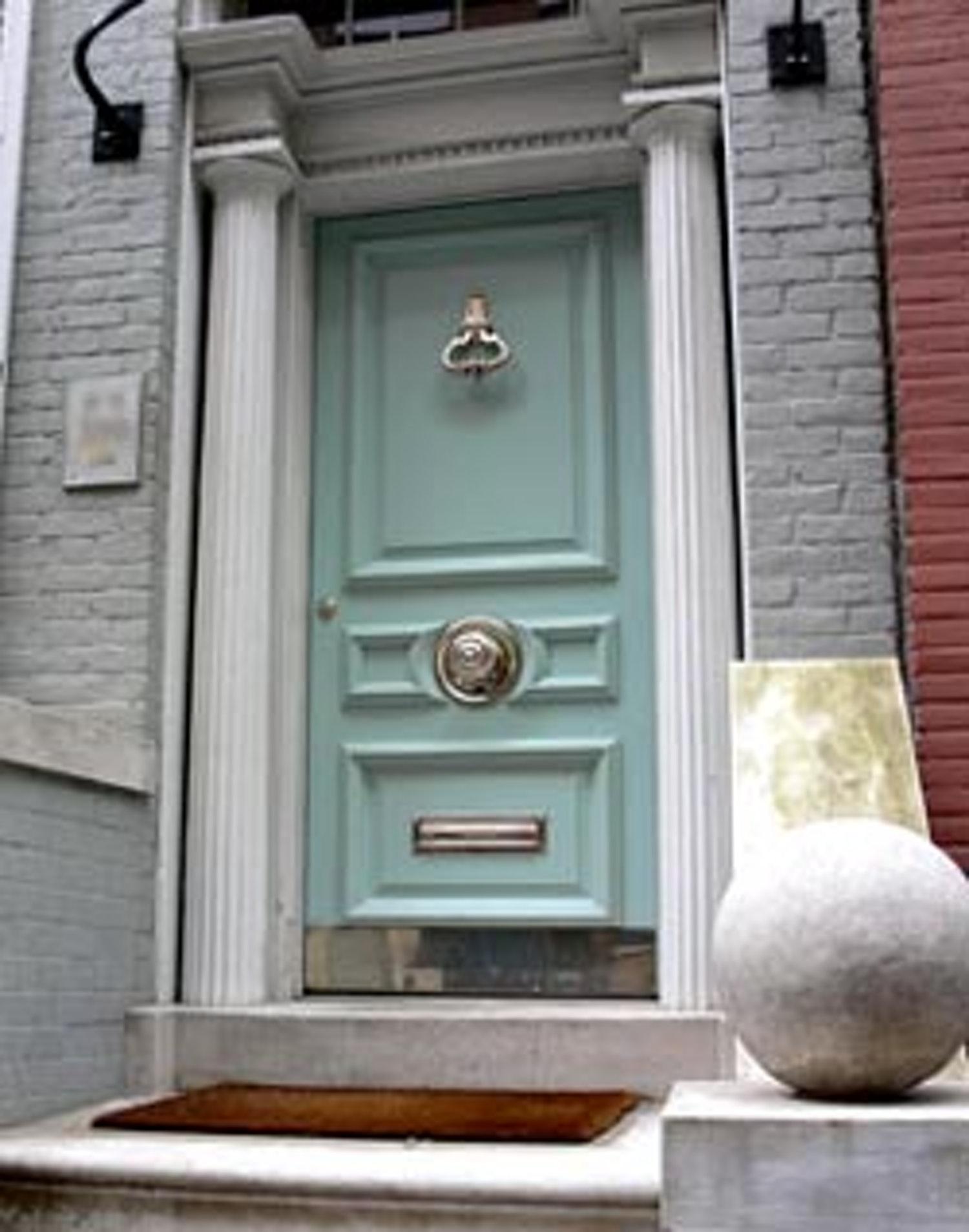 door knob in center of door photo - 2