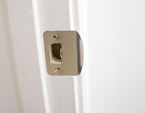 door knob strike plate photo - 1