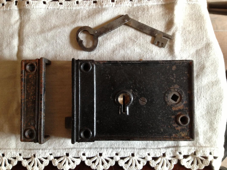 door knob with lock and key photo - 12