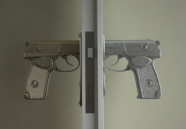 gun door knobs photo - 2