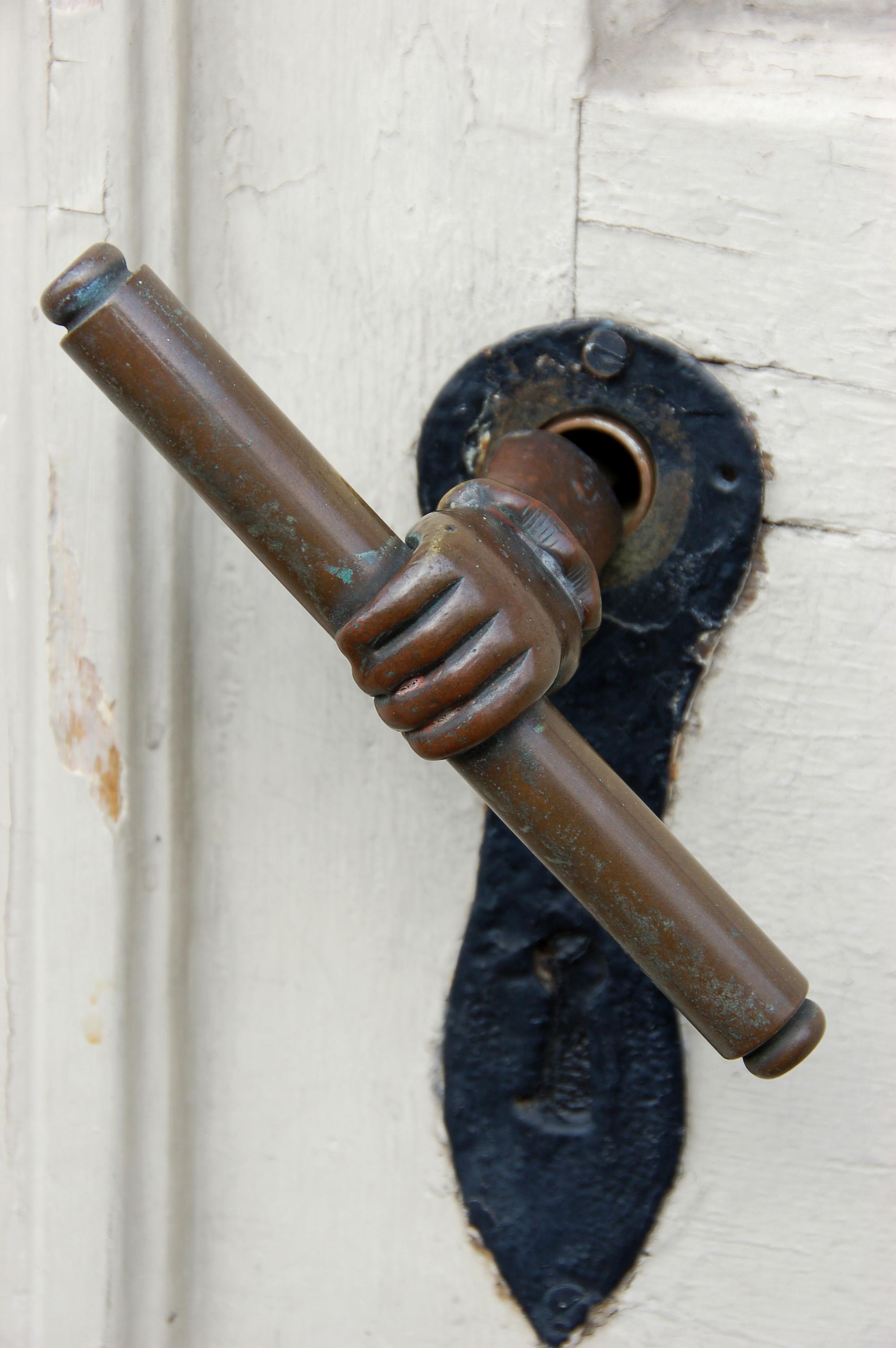 hand on door knob photo - 1