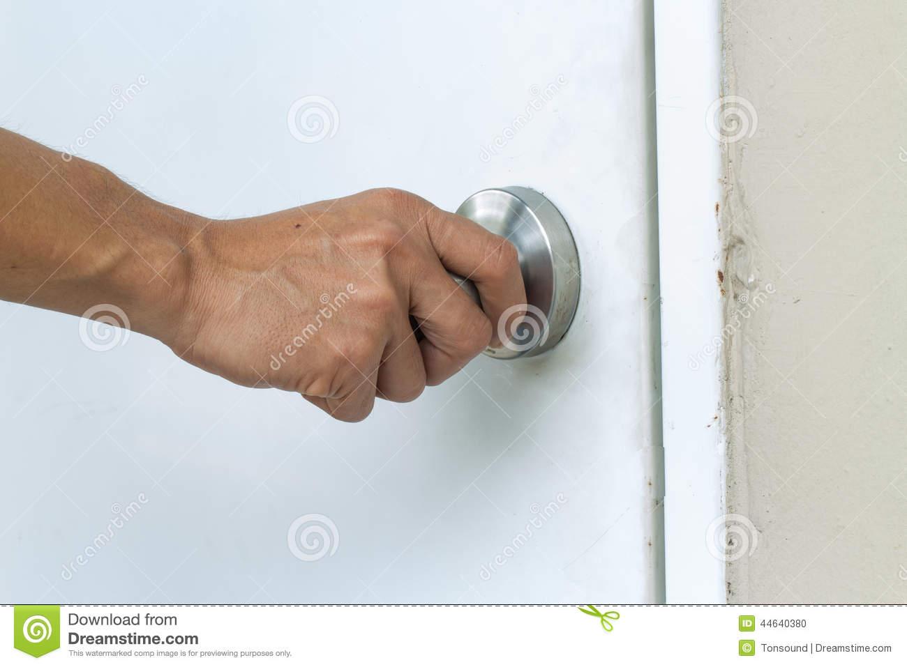 hand on door knob photo - 10