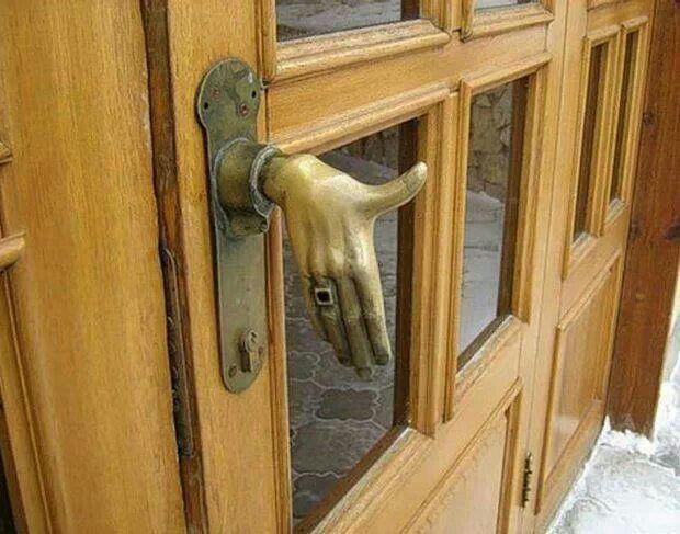 hand on door knob photo - 11