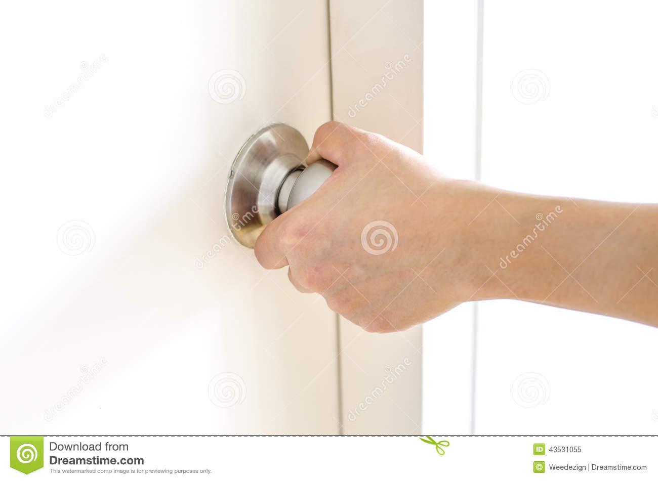 hand on door knob photo - 12