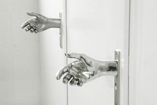 hand on door knob photo - 13