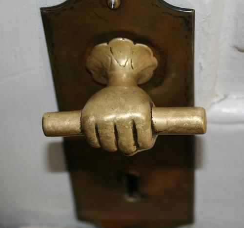 hand on door knob photo - 17