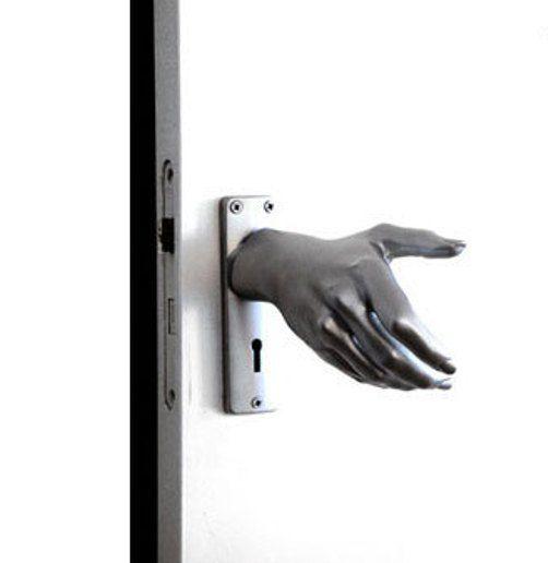 hand on door knob photo - 18