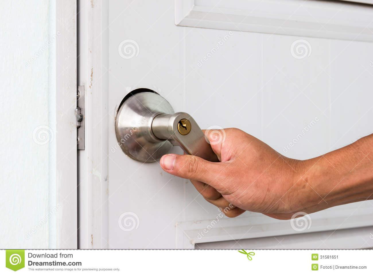 hand on door knob photo - 19