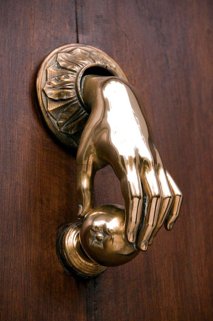 hand on door knob photo - 5