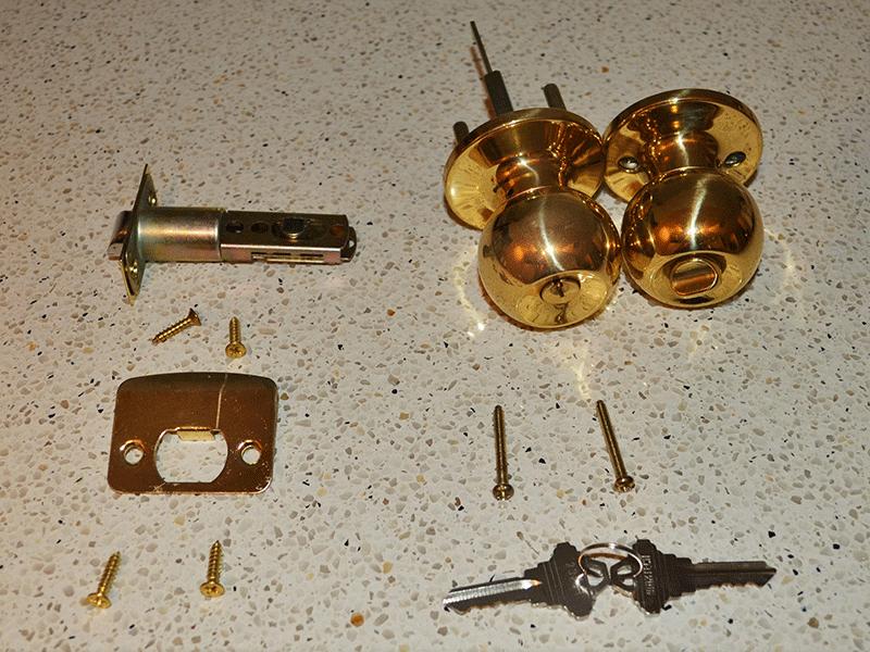 parts to a door knob photo - 5