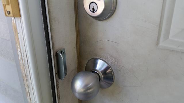 storm door knob photo - 13