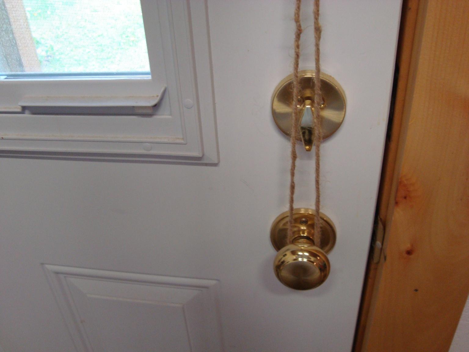 taking off a door knob photo - 18