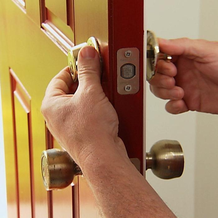 taking off a door knob photo - 19