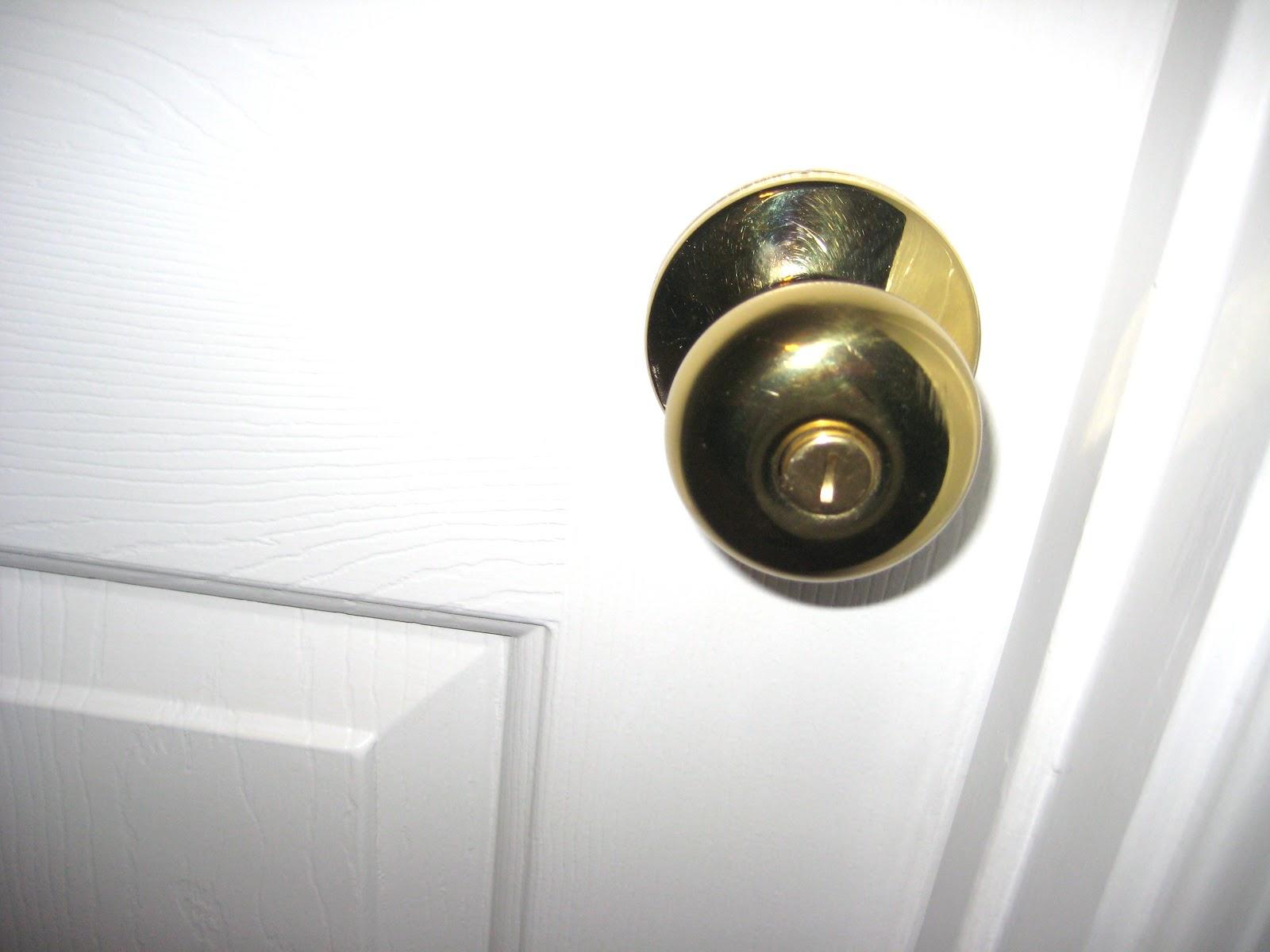 taking off a door knob photo - 7