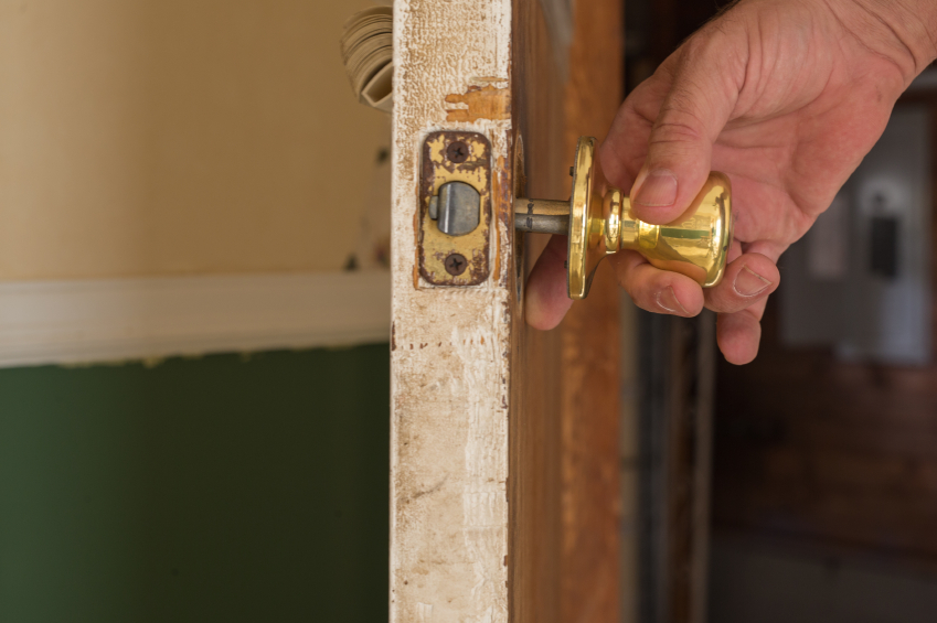 taking off a door knob photo - 8