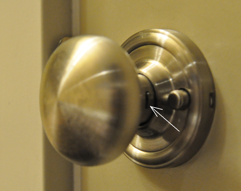 taking off a door knob photo - 9
