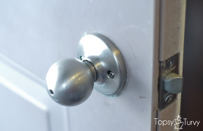 tighten door knob photo - 20
