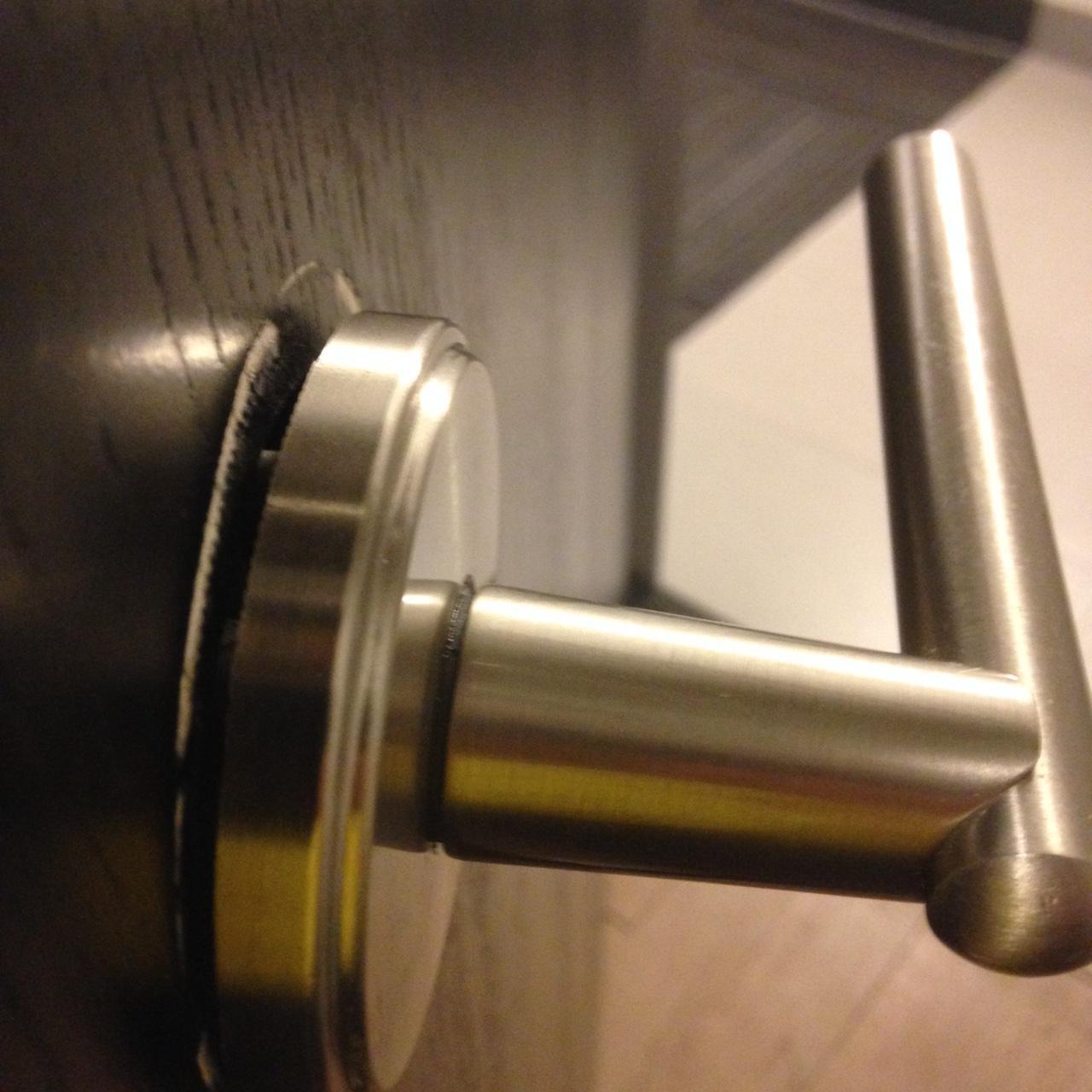 tighten loose door knob photo - 2