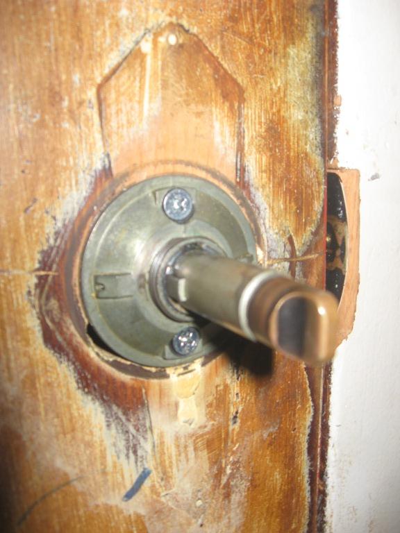 tighten loose door knob photo - 6